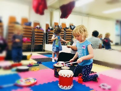 Playing the drums at Music Together SoHy