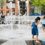 Kids playing in water fountain at Riverdale Park Station, Riverdale Park