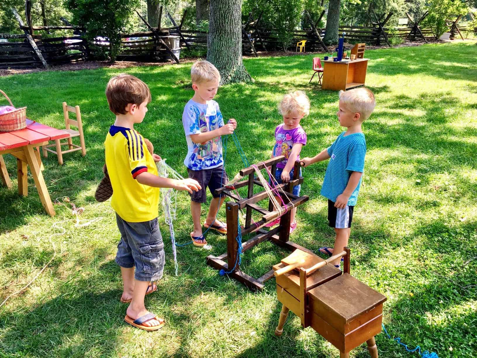 Kids playing at Hands-on-History Playground at Montpelier Mansion