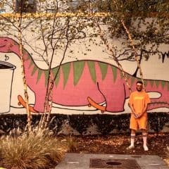 Vigilante Coffee College Park gets a new skateboarding pink dinosaur mural!