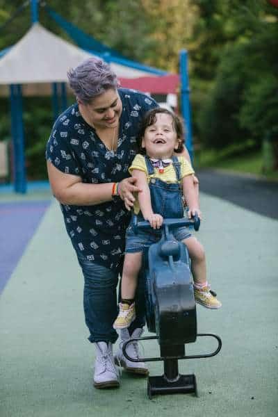 Photo by Erika Nizborski - folks have fun on the playground