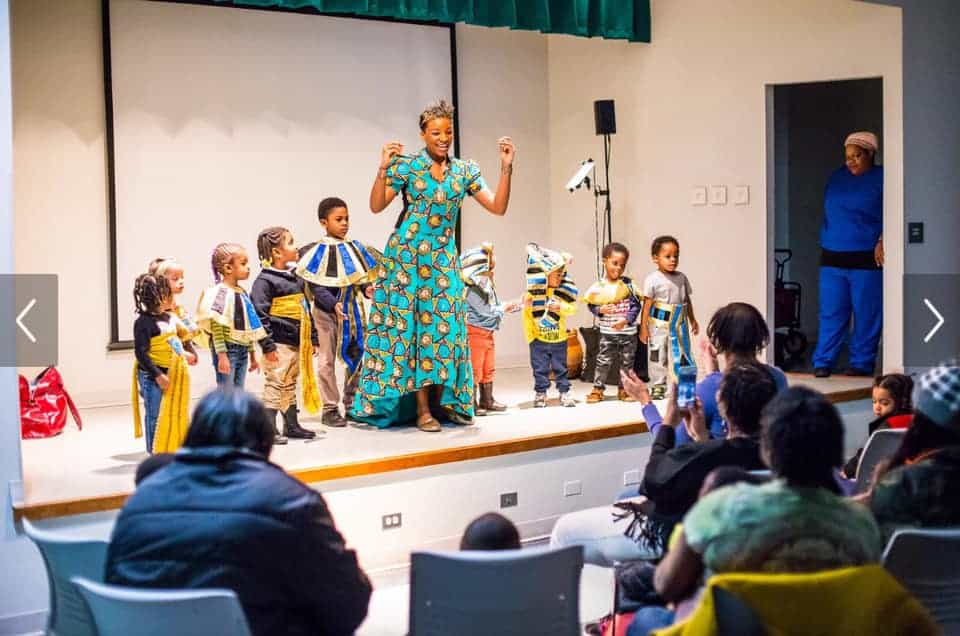 Culture Queen performing her songs with kids