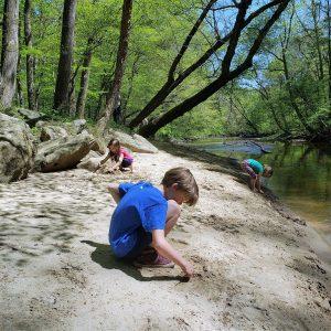 Playing along creek at Rachel Carson Trail