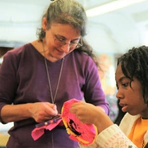 Suzanne Herbert-Forton teaching embroidery