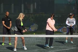 Playing tennis outside